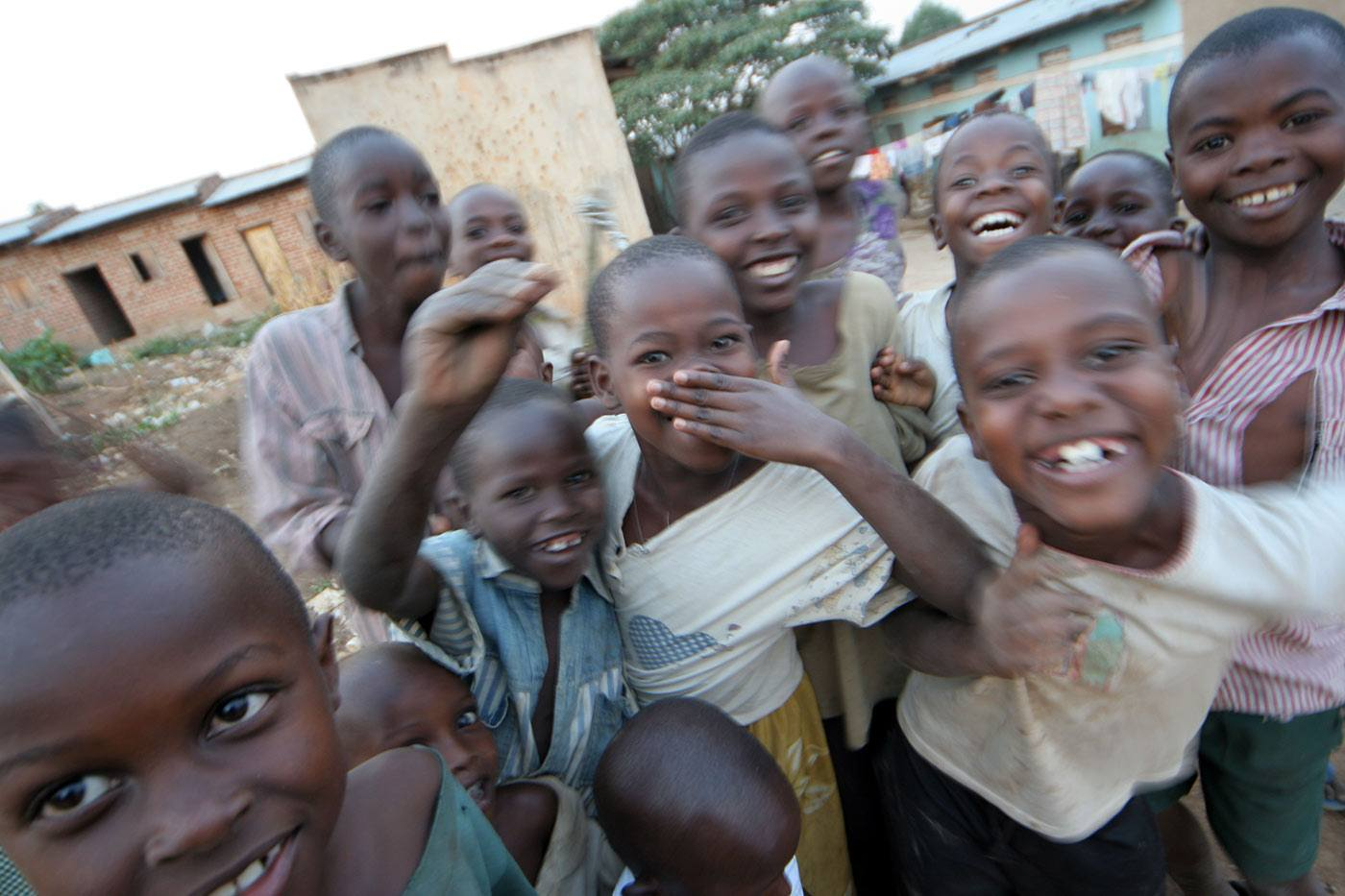 a group of smiling children in a developing country