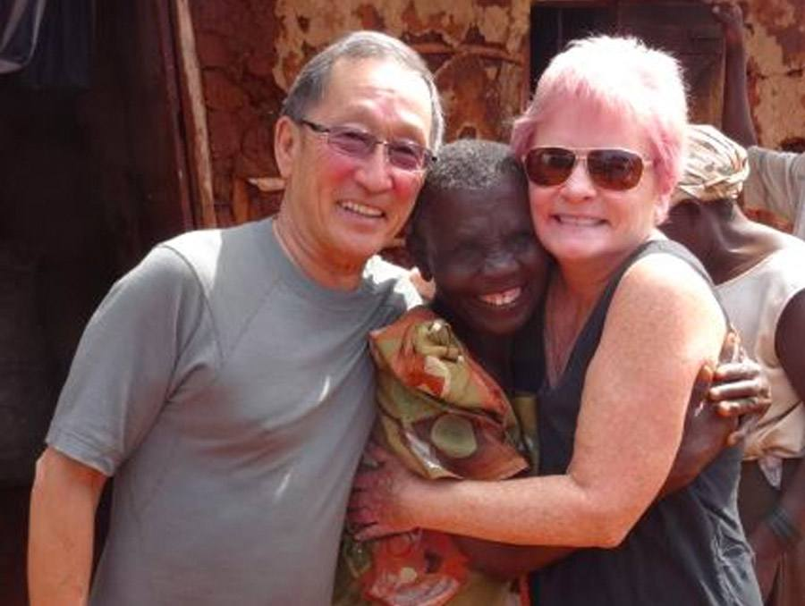 volunteers Val and Terry posing with a woman in a developing country