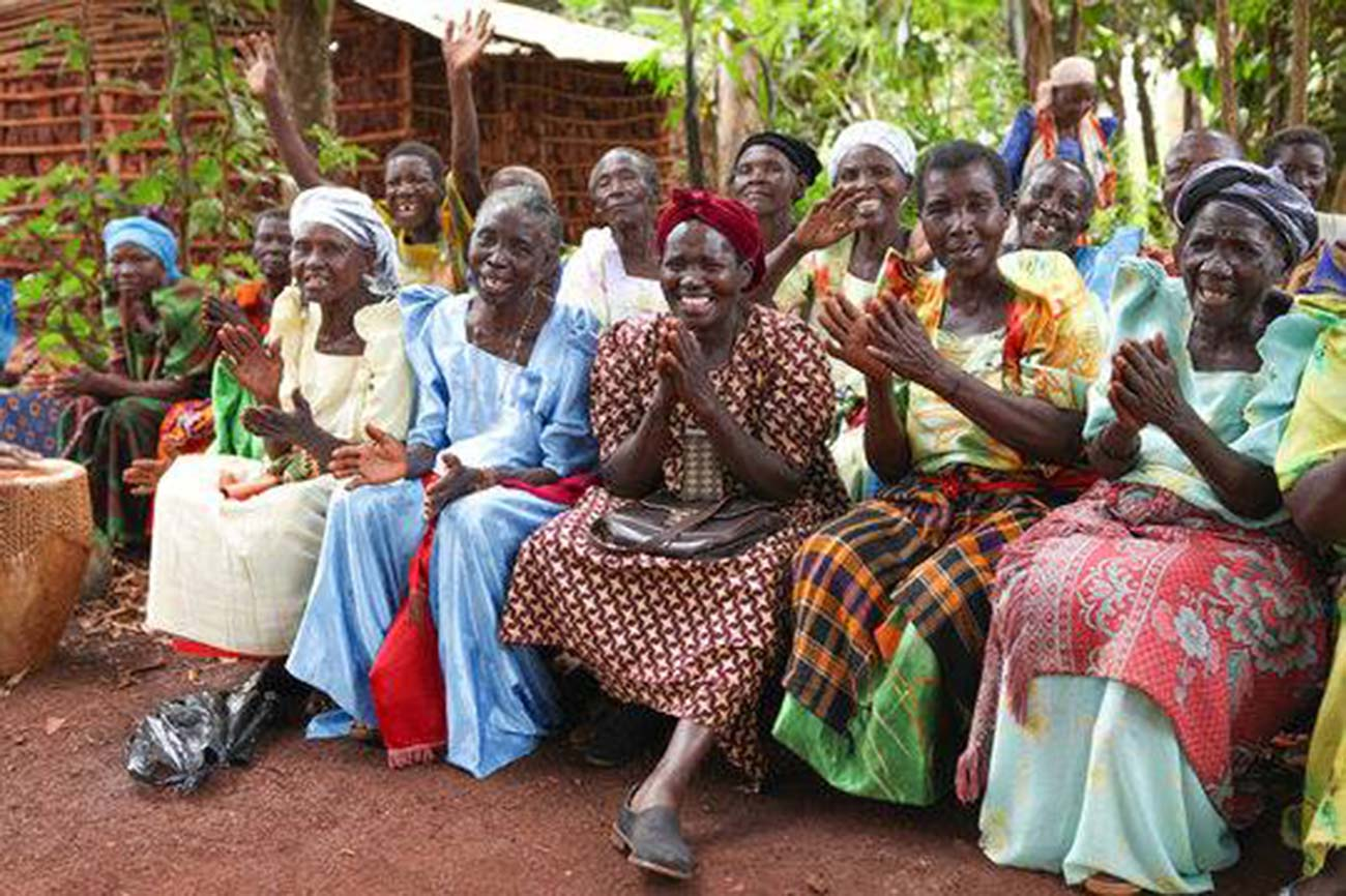 elderly women smiling and clapping as a part of the Grandmothers Initiative