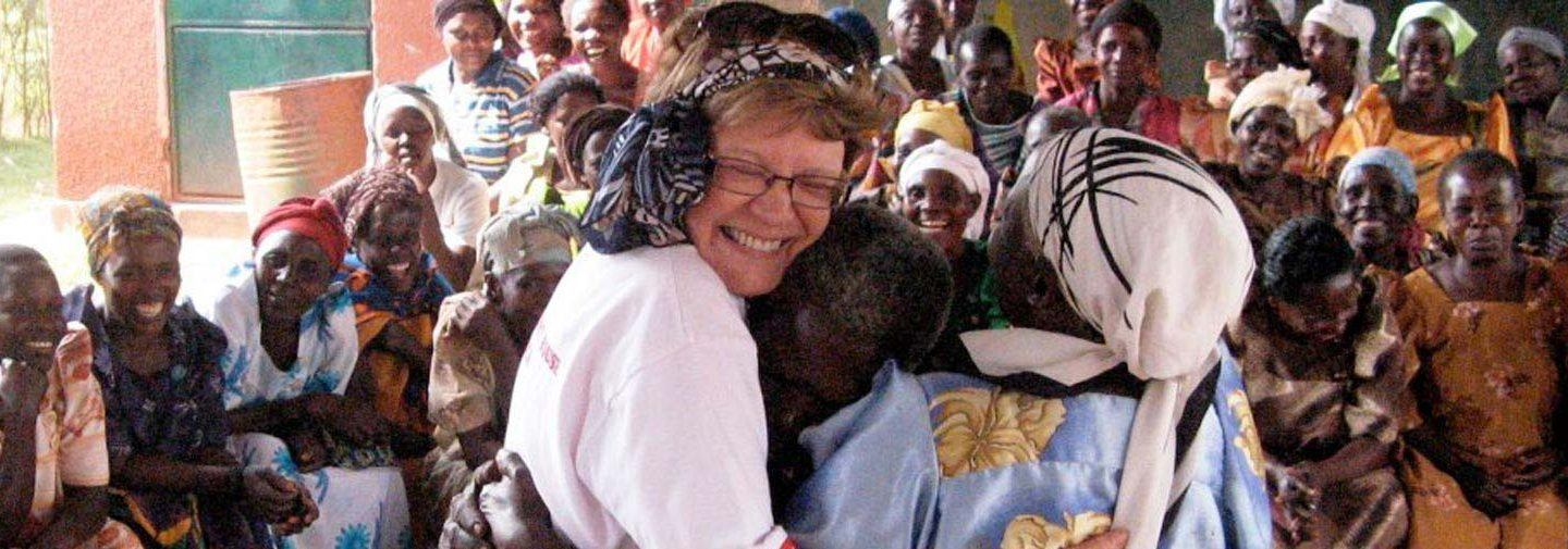three women hugging in celebration as part of the Grandmothers Initiative