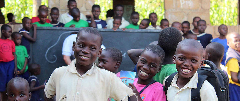 a group of smiling schoolchildren in Kenya