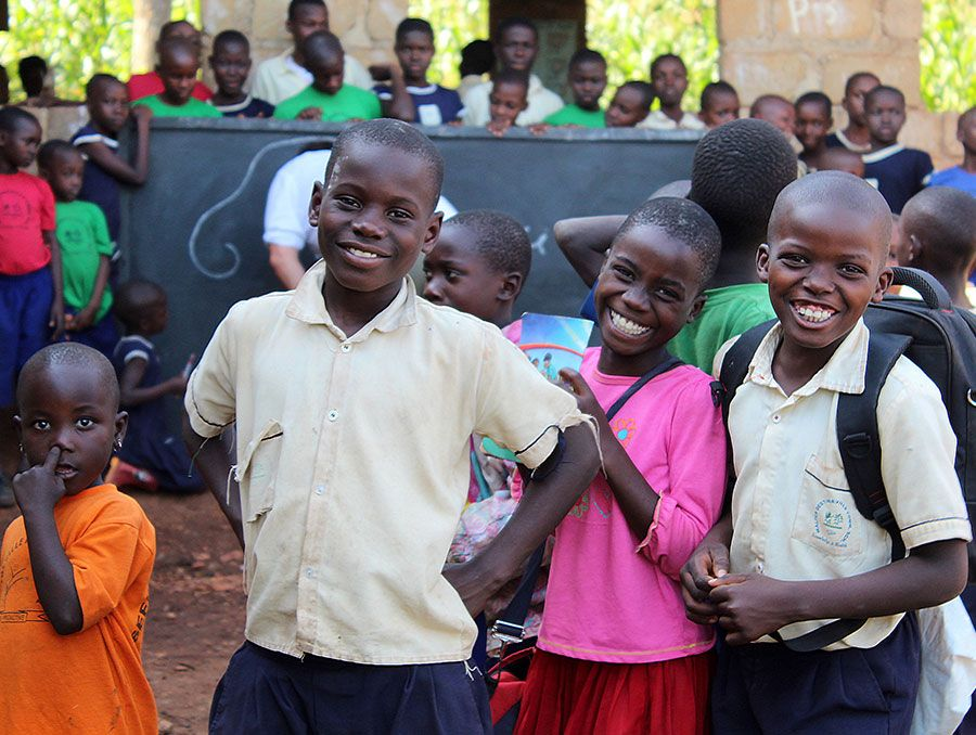 a group of smiling schoolchildren in a developing country